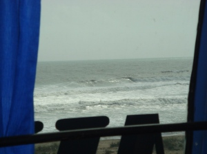 View of ocean through the window of our bus