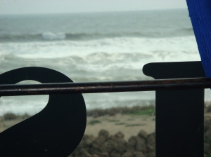 View of ocean through another window