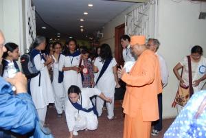 Swami Nikhileswrananda is greeting – Oops! Something fell down