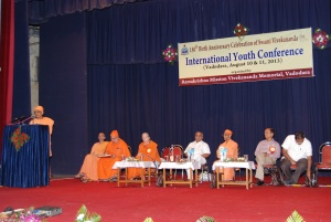 Swami Nikhileswarananda addressing the audience  -special guests on the stage