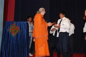 Pr. Shuddhatmaprana giving gifts to Vidyapith students